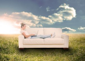 Woman on couch in field